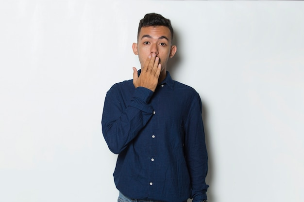 Young business man shocked covering mouth with hands for mistake secret concept