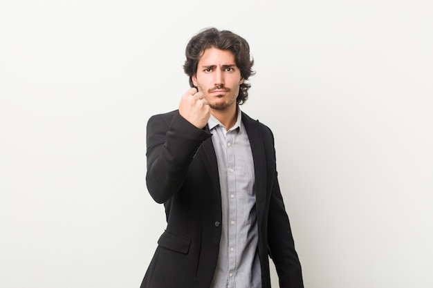 Young business man showing fist