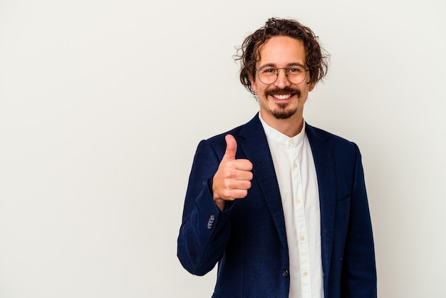 Young business man   smiling and raising thumb up