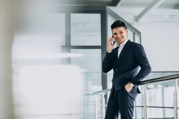 Young business man talking on phone in the office
