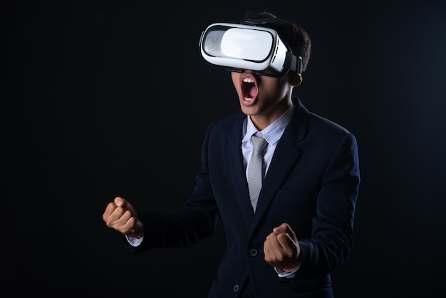 Young business man wearing virtual reality glasses