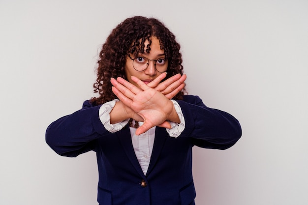 Young business mixed race woman isolated on white doing a denial gesture