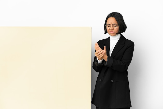 Young business mixed race woman with with a big banner isolated background suffering from pain in hands