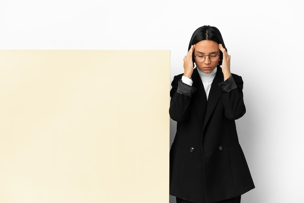 Young business mixed race woman with with a big banner over isolated background with headache
