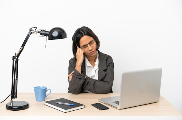 Young business mixed race woman working at office with headache