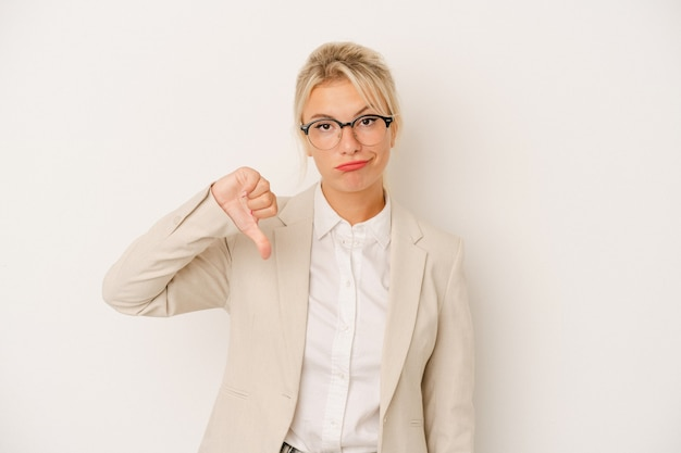 Young business russian woman isolated on white background showing a dislike gesture, thumbs down. disagreement concept.