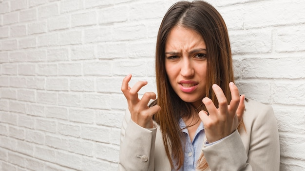 Young business woman angry and upset