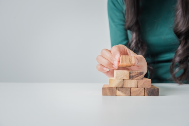 Young business woman asian playing with wooden blocks