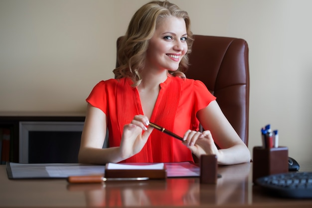 Young business woman in chair