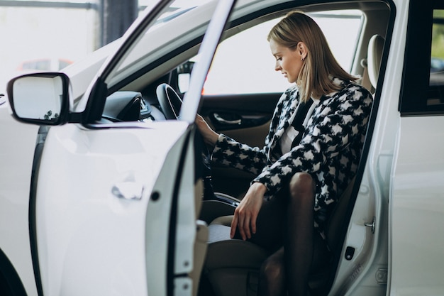 Young business woman choosing a car