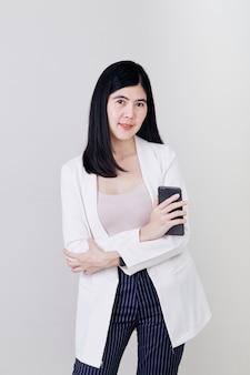 Young business woman enjoying  phone