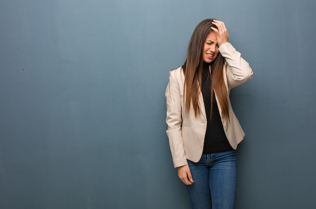 Young business woman forgetful, realize something