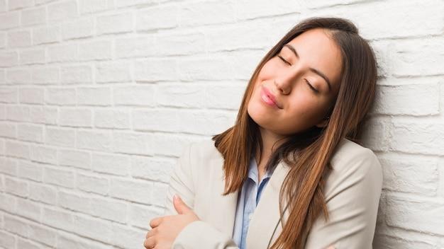 Young business woman giving a hug