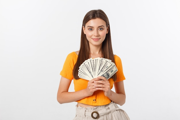 Young business woman holding money isolated.