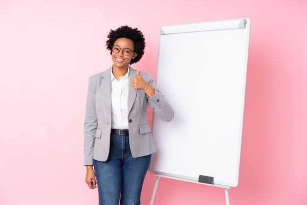 Young business woman over isolated wall