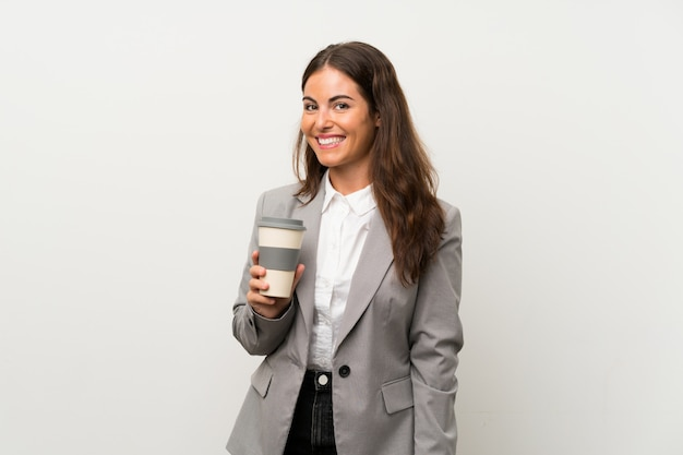 Young business woman over isolated white wall
