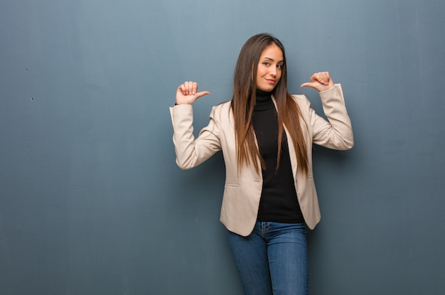 Young business woman pointing fingers, example to follow