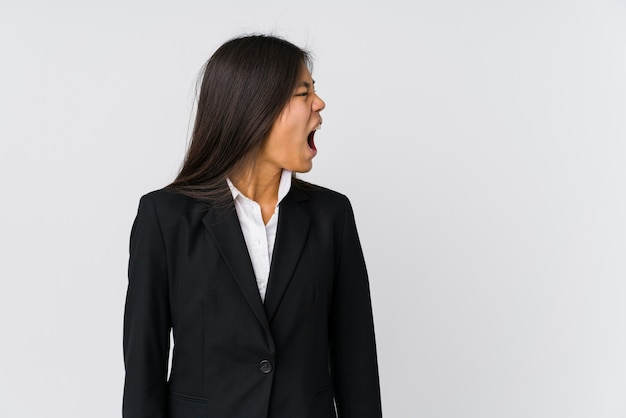 Young business woman shouting towards a copy space