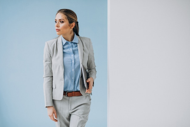 Young business woman standing in the office isolated