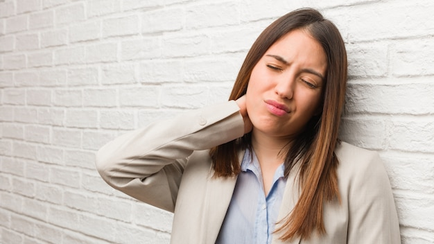 Young business woman suffering neck pain