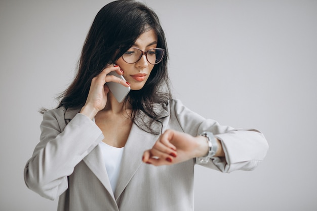 Young business woman talking on the phone at the office