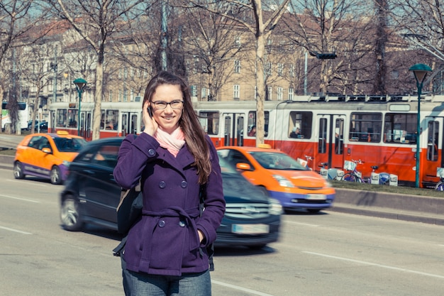 Young business woman next to urban road