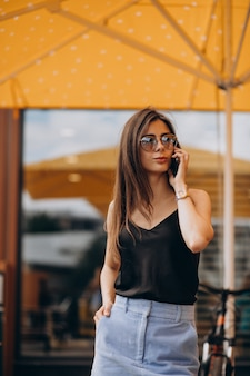 Young business woman using phone on a vacation