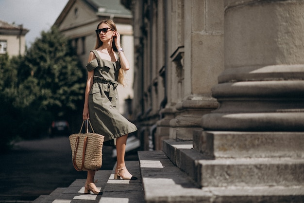Young business woman walking up the stairs