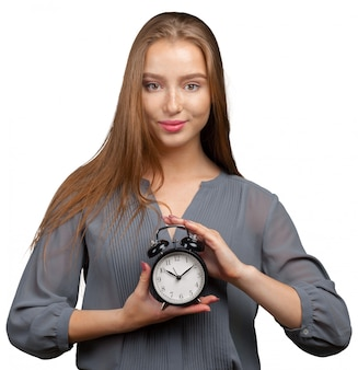 Young business woman with clock