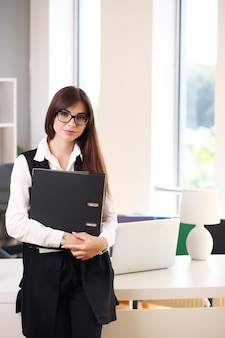 Young business woman working in her office using a laptop