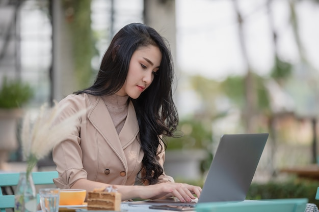 Young business women checking mail documents on laptop