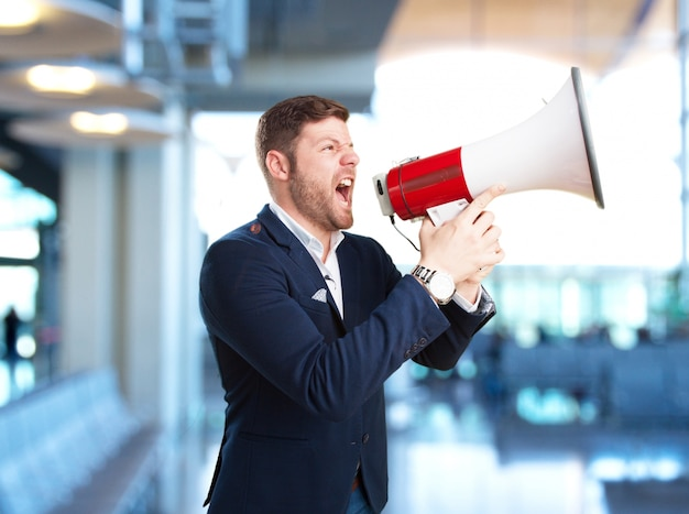 Young businessman angry expression
