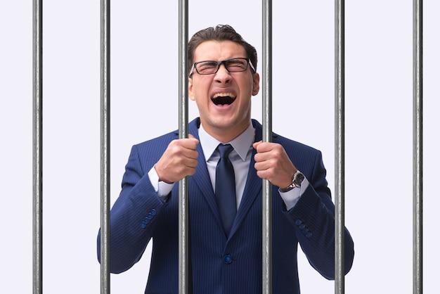 Молодой бизнесмен за решеткой в тюрьме