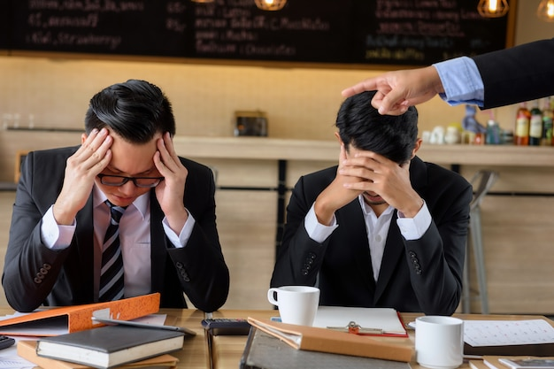 Young businessman blamed by piss off boss