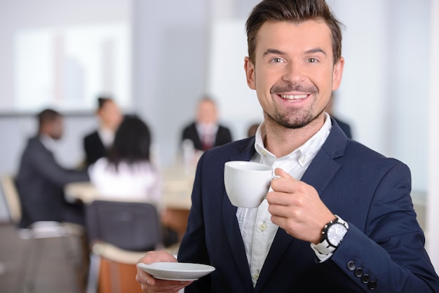 Young businessman drinking coffee.