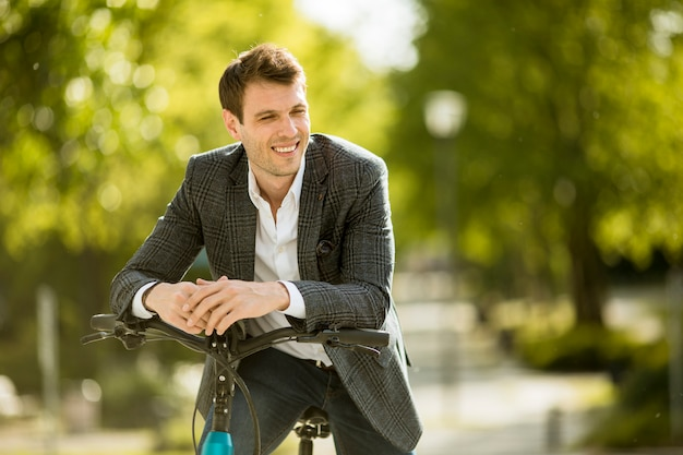 Young businessman on the ebike