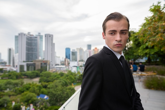 Young businessman exploring the city of bangkok, thailand