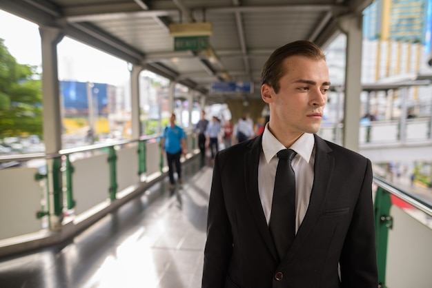 Young businessman exploring the city of bangkok, thailand