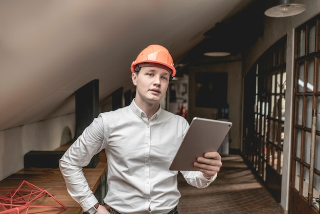 Young businessman in hard hat helmet  work in building company