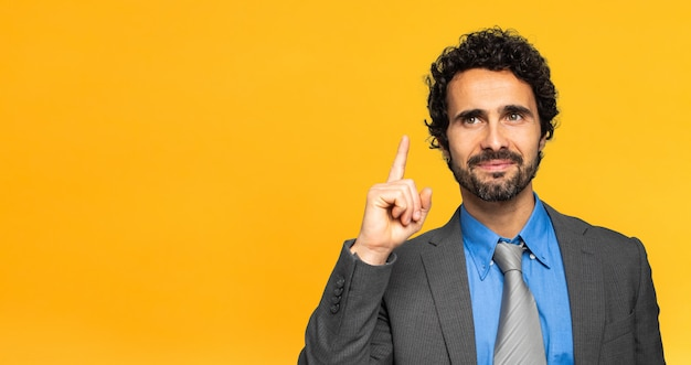 Young businessman having a solution on yellow