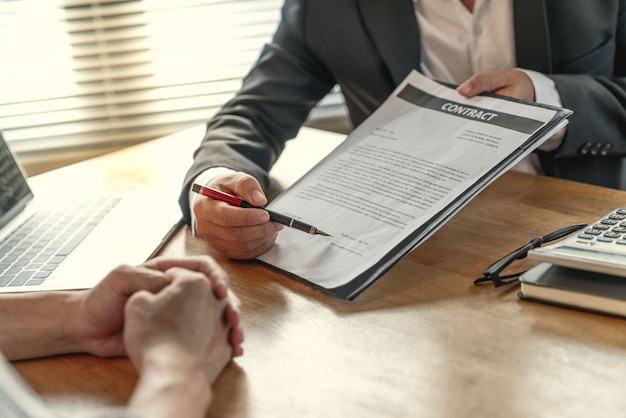Young businessman and home buyer customer had achieve target means together and signed in the contract of sale of real estate