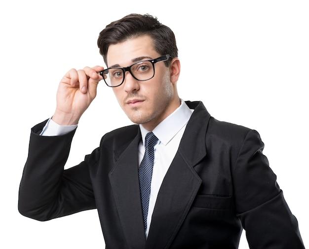 眼鏡、ネクタイ、黒のスーツ、白で隔離の青年実業家