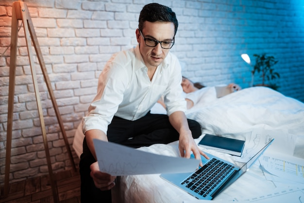 Young businessman is looking at sheet of paper