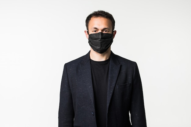 Young businessman is trying on a medical mask in the midst of a coronavirus pandemic