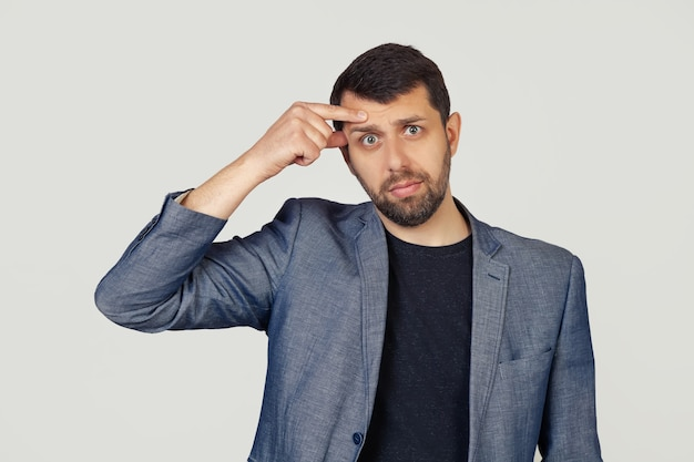 Premium Photo   Young businessman man with a beard in a jacket, pointing to  an unhappy pimple on his forehead, an ugly acne infection. acne and skin  problems.