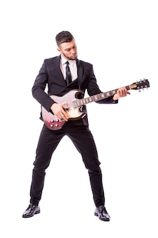 Young businessman playing guitar isolated on white wall