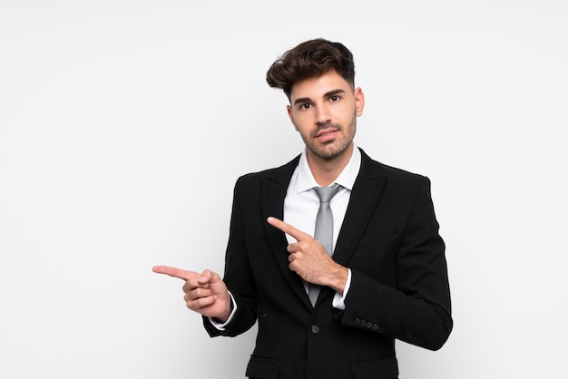 Young businessman pointing finger to the side