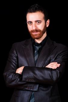 Young businessman portrait on a black background