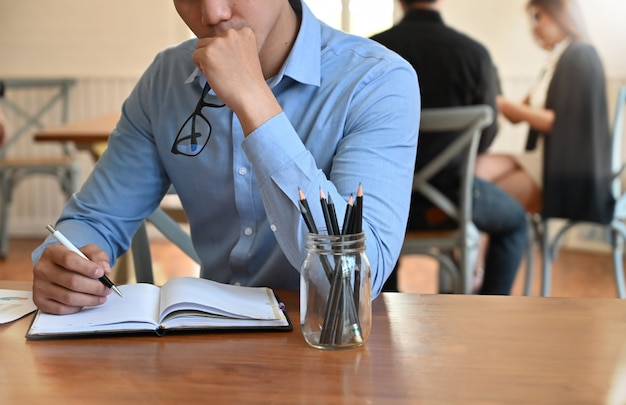 Young businessman serious on coworking space