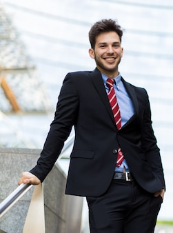 Young businessman on some stairs outdoor